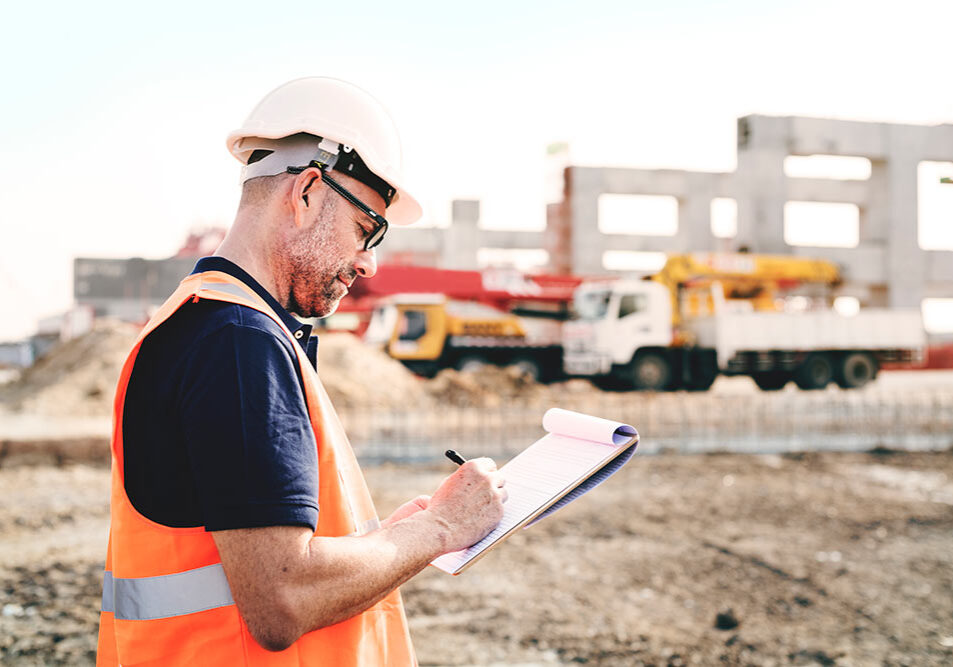 Commercial general contractor reviewing paperwork